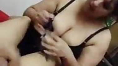 Indian couple enjoying in hotel room